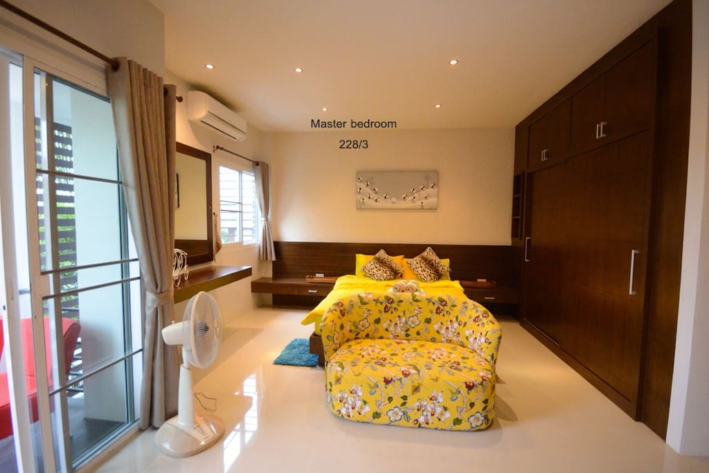 House number 2 //master bedroom comes with AC, TV and balcony with outdoor seating.
