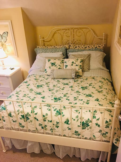 Cozy custom bedding with high thread count sheets and ample pillows.
