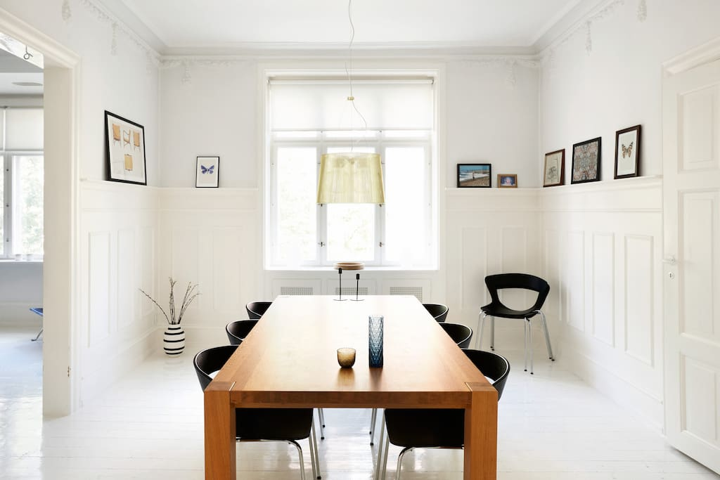 Light, spacious dining room with space for six-eight people.