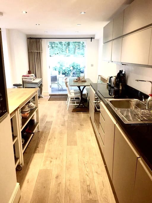Open plan kitchen diner with french doors leading out to garden