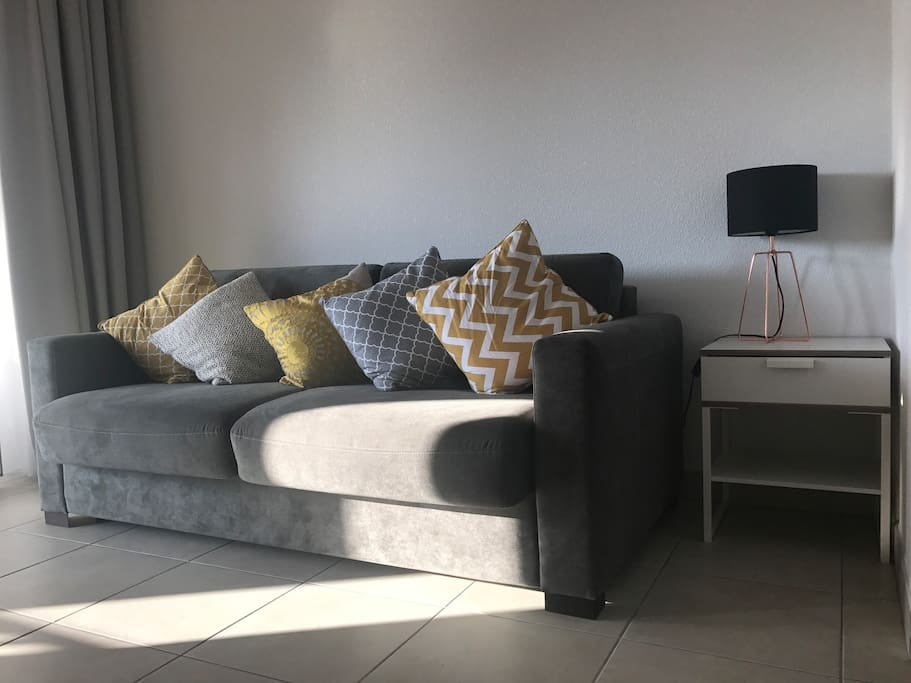 Light and airy lounge with big screen TV with local channels, Wi-Fi,  Bluetooth speaker and patio doors to terrace
