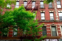 Four flight walk up apartment in a quaint but old tenement building. Family in the building for flexible check in options.