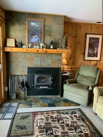 Cozy up by the Lake. Unit 6 features a living room with radiant in-floor heating overlooking Lake Superior.