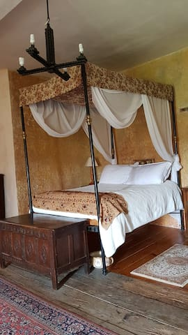 The master bedroom. Situated within the castle tower with a comfortable four poster bed and a wonderful medieval atmosphere