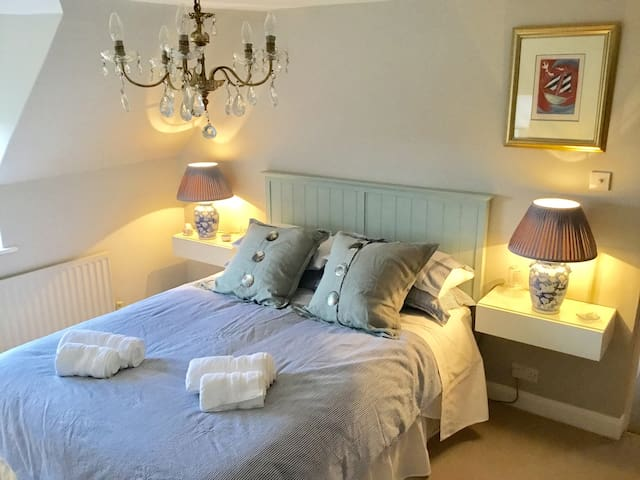 This is a lovely sunny room, weather permitting, with a King size bed and plenty of storage. You probably won't want it but this room has a t.v.