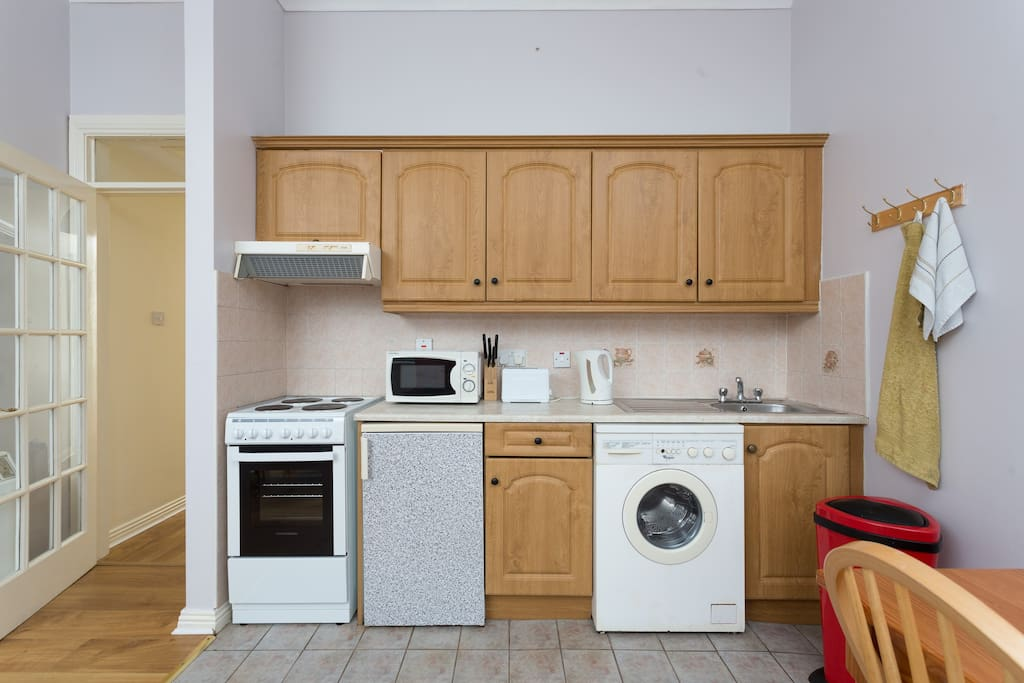 Oven, hob, washing machine with clothes dryer, fridge, microwave etc.