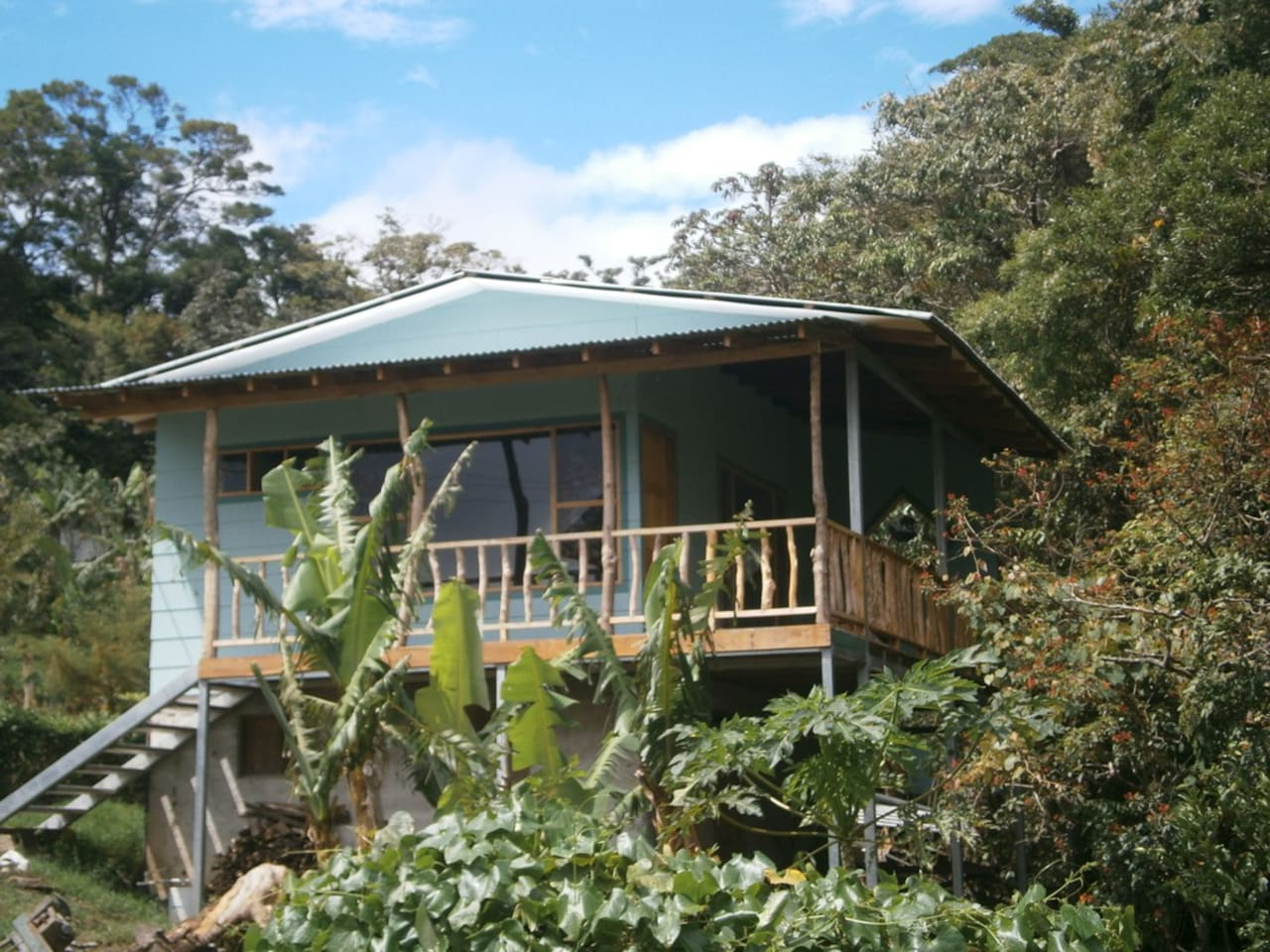 Casa Libelula is nestled alongside the forest over the creek.