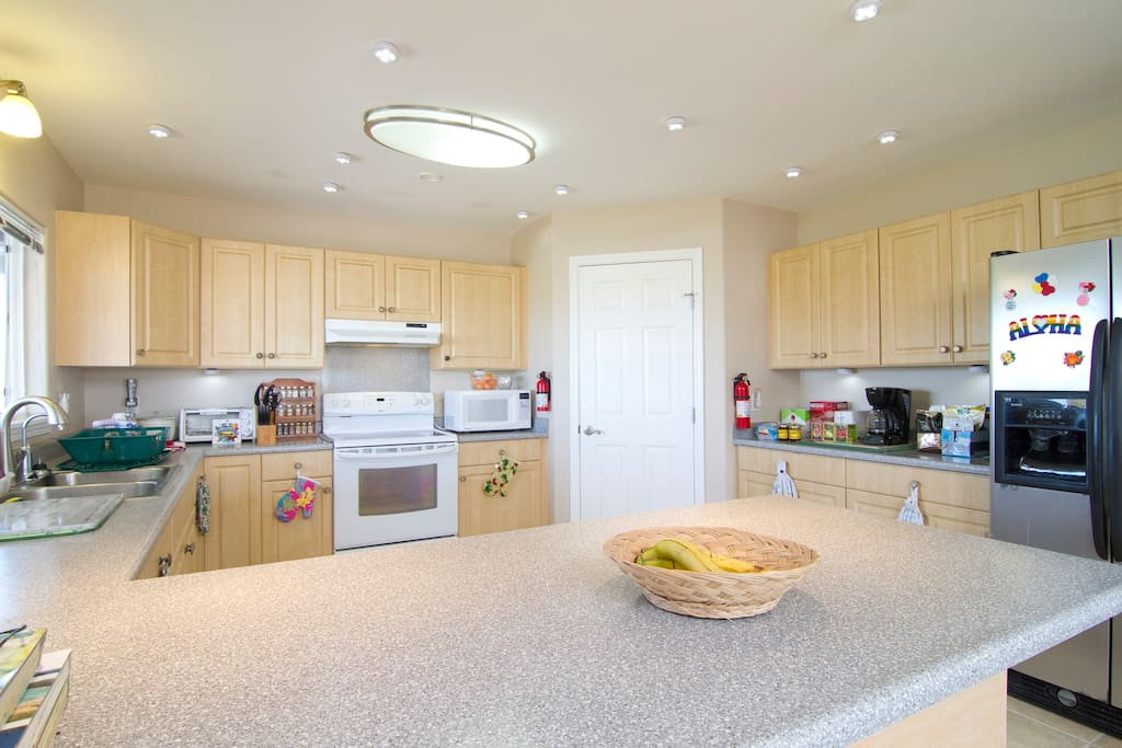 Spacious kitchen with counter seating.