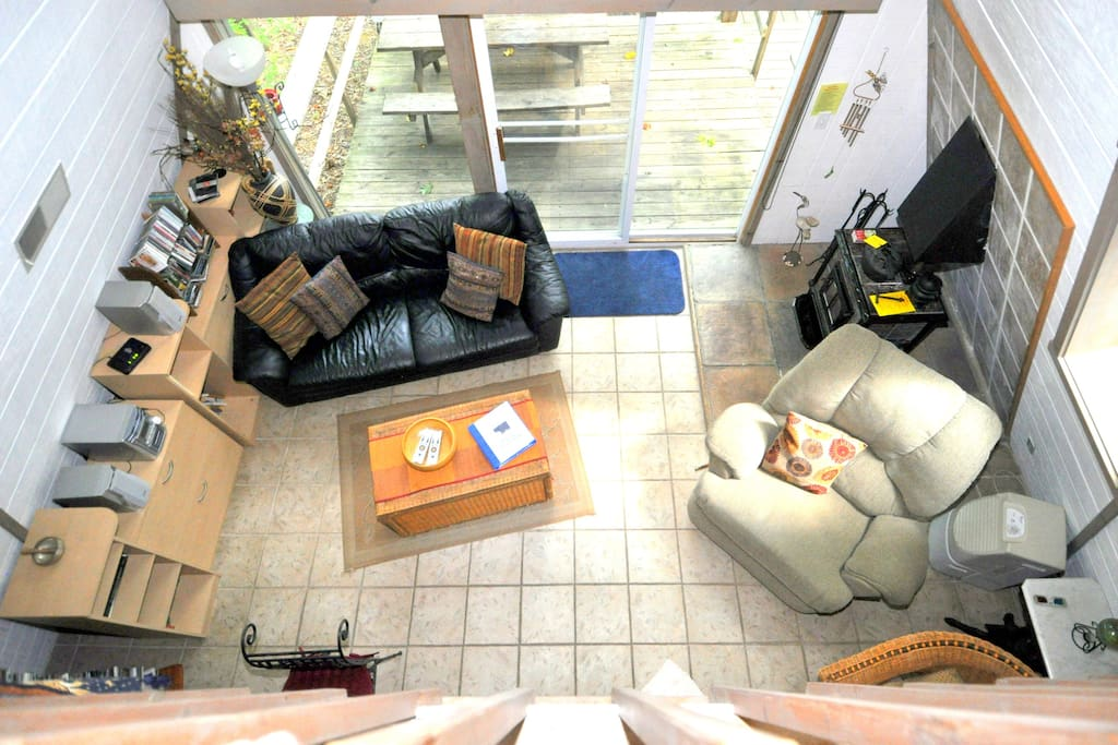 A view from the loft! Kick back in the comfy living room with a wood stove.