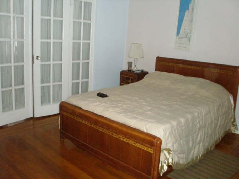 First bedroom, the double doors lead to the second bedroom.