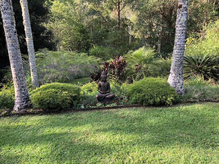 Peaceful spacious home on lush private acreage