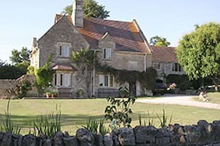 Delightful former Cotswold Rectory in large garden