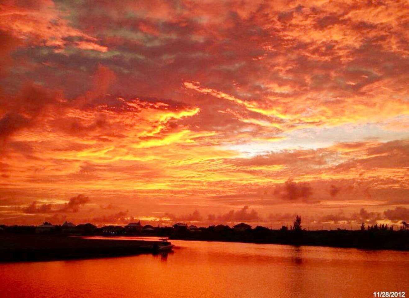 "A beautiful ""Red Sunrise""  from the lagoon side balcony of the ""Sanctuary"" Careenage Condominiums, at Cayman Grand Harbour, Cayman Islands"