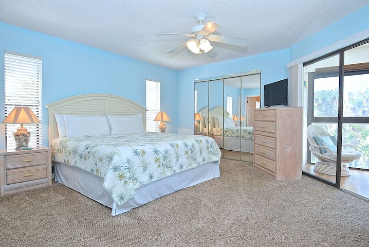 The large master bedroom has a king size bed and plenty of storage space