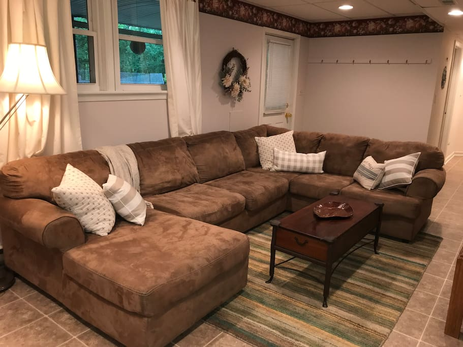 Cozy living room, complete with sectional, flat screen tv, DVD player, select DVDs