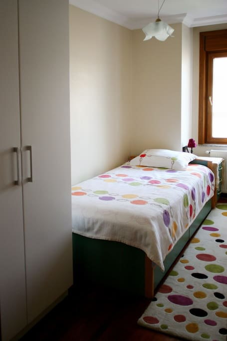 the guest room has a  large wardrobe and bedside table.