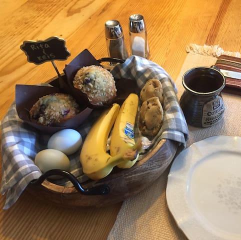 Breakfast includes coffee, tea, muffins, bananas, hardboiled eggs and homemade cookies.