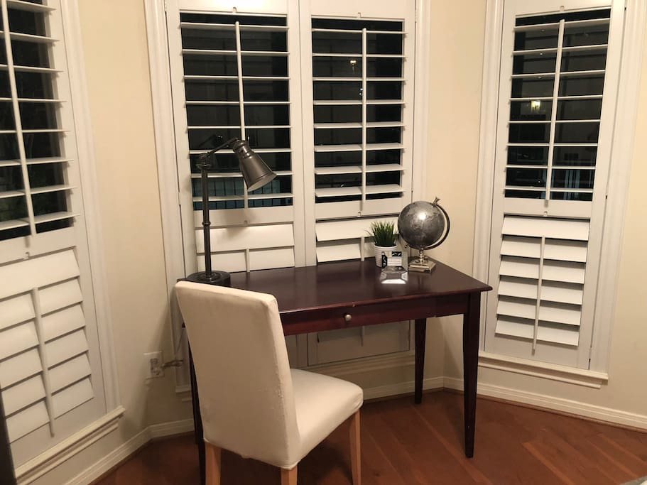 Desk space for work or charging.  Plantation blinds for privacy.