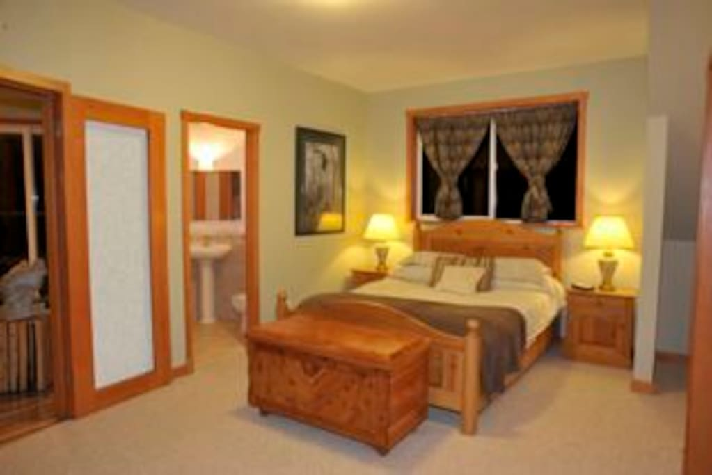 Longhouse Bay getaway 1 bedroom master bedroom with glass and tile shower + 2 piece bathroom