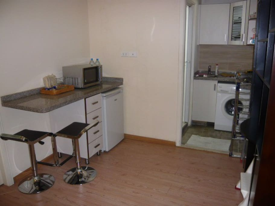 Kitchen fully equipped +bar