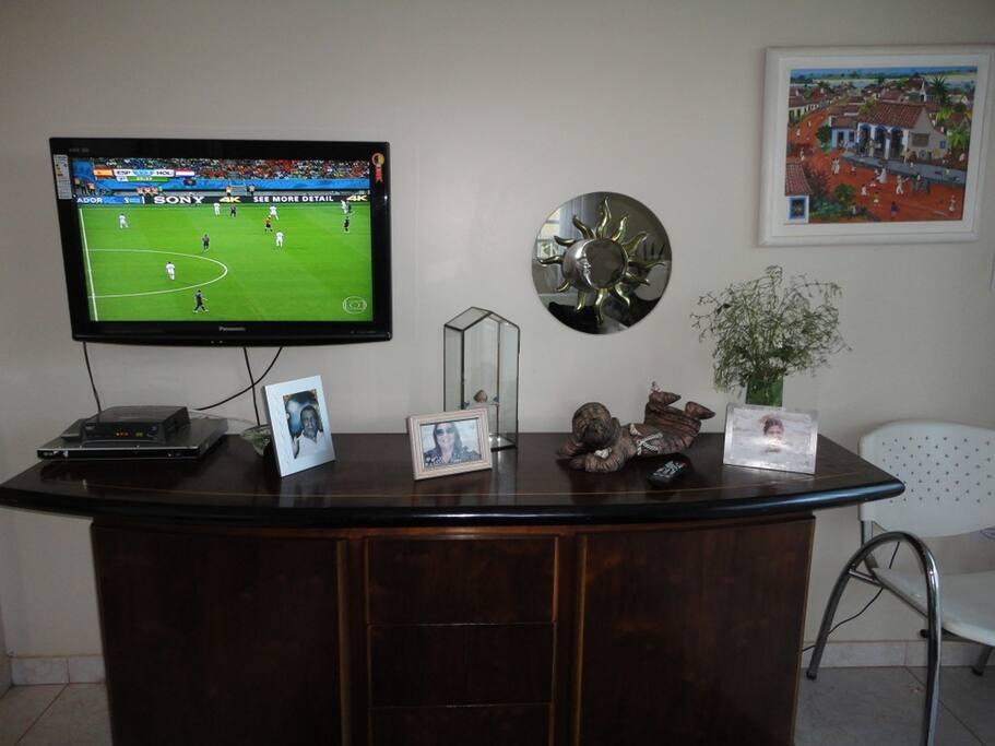 espaço comum: sala de visitas com TV