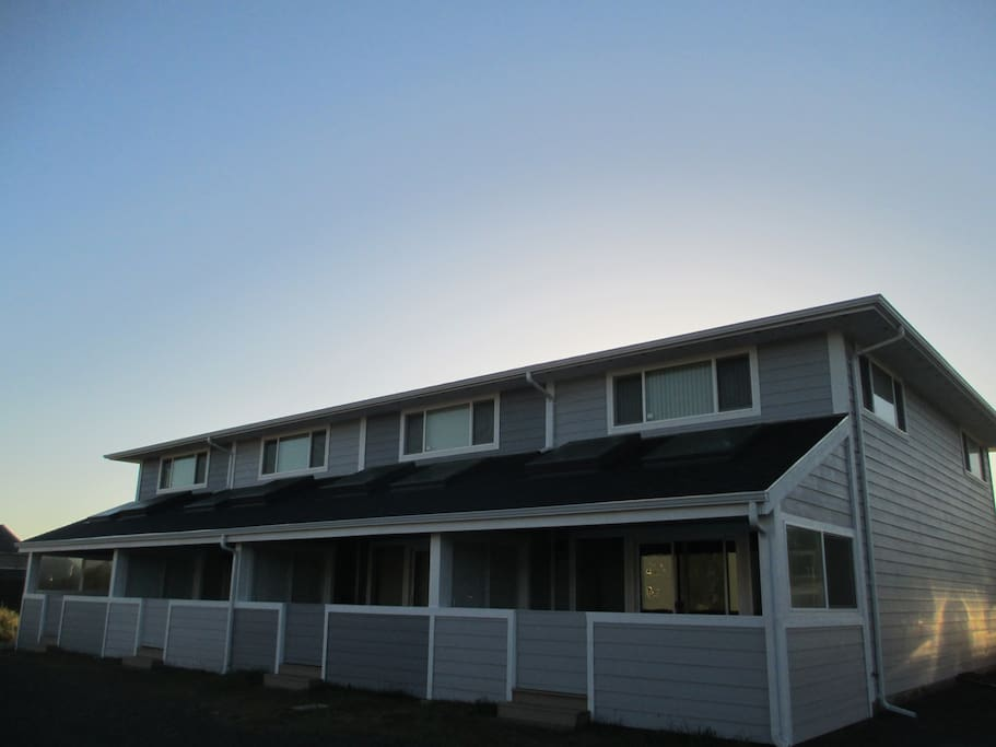 Back of Nye Beach Townhomes showing the covered decks