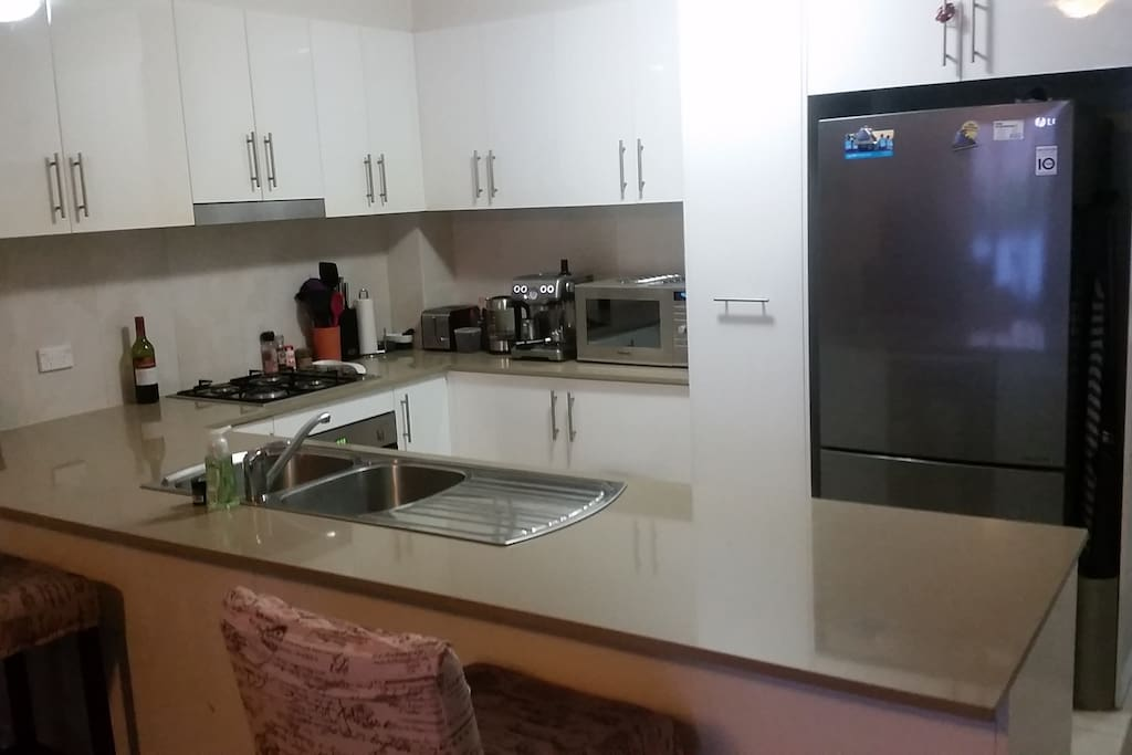 Kitchen with casual dining/work area