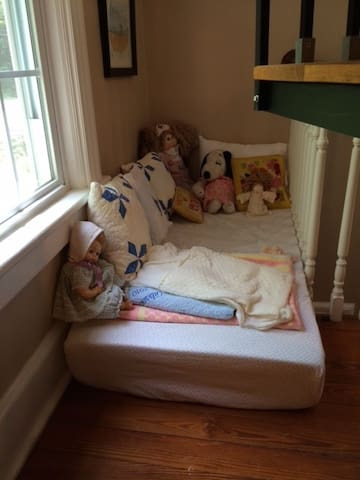 Secret reading nook for kids on second floor landing.
