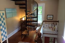 Second floor landing. Spiral staircase leads to the 3rd floor bedroom and bath.