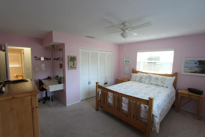 Pink Bedroom with SmartTV