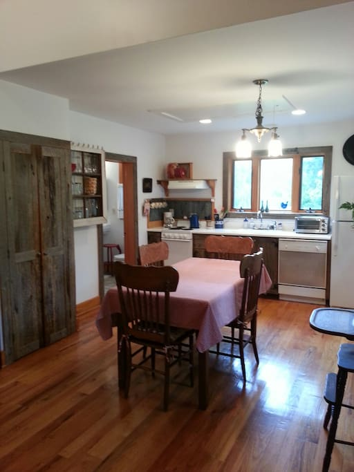 Kitchen has dishes, pots and pans, dishwasher, toaster oven and coffee maker