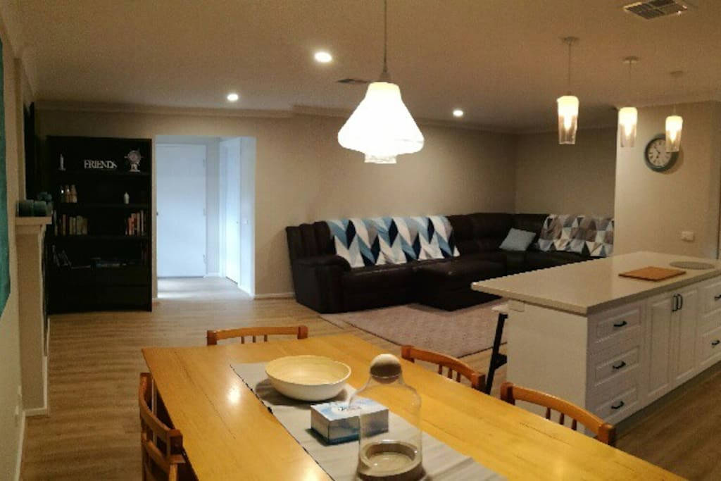 open plan living area and kitchen with the largest and most comfy couch