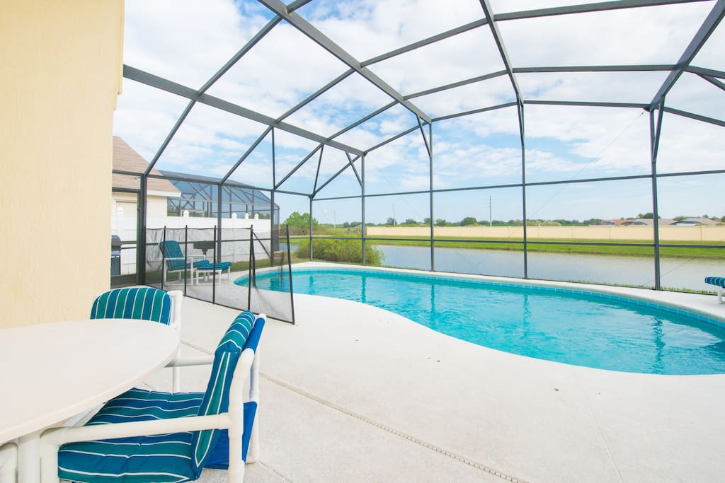 Pool area and deck along with safety fence