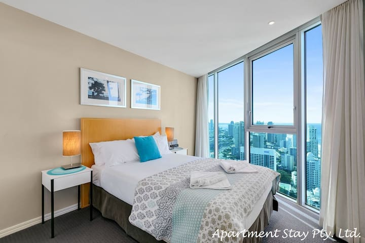 EMERALD COAST - Second bedroom has queen bed. Enjoy sparkling ocean views. Bed linens and towels supplied.