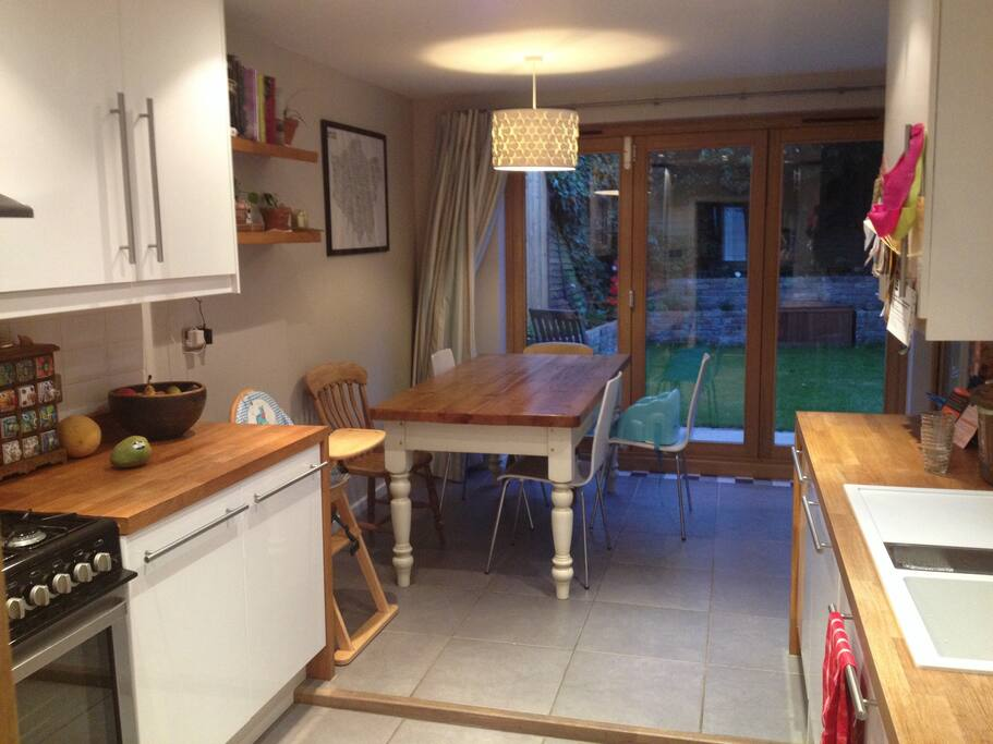 Bifold doors to the garden.  Double oven/range with 8 hobs