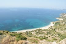 Lefka beach(3km away), can only be reached by foot.