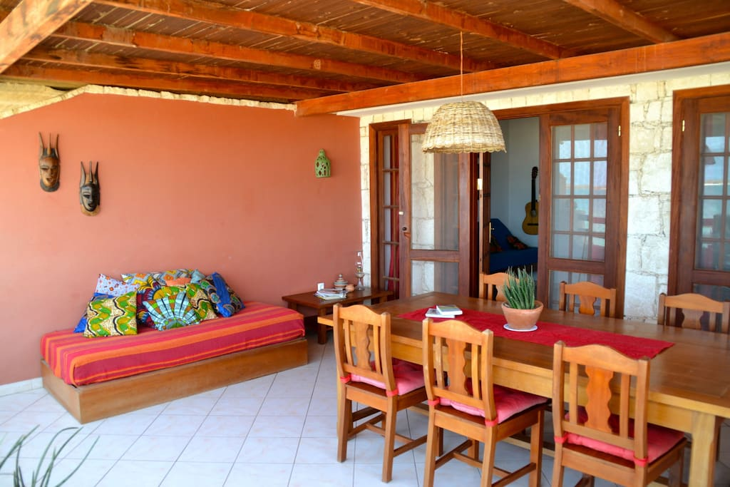 The balcony have a table where you can enjoy all your meals and a sofa where you can just relax and see the sunset