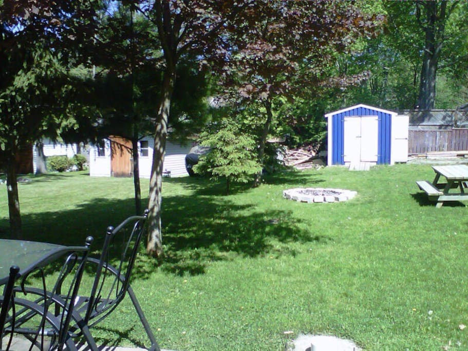 Big backyard with bbq, fire pit, patio seating, garden and more!
