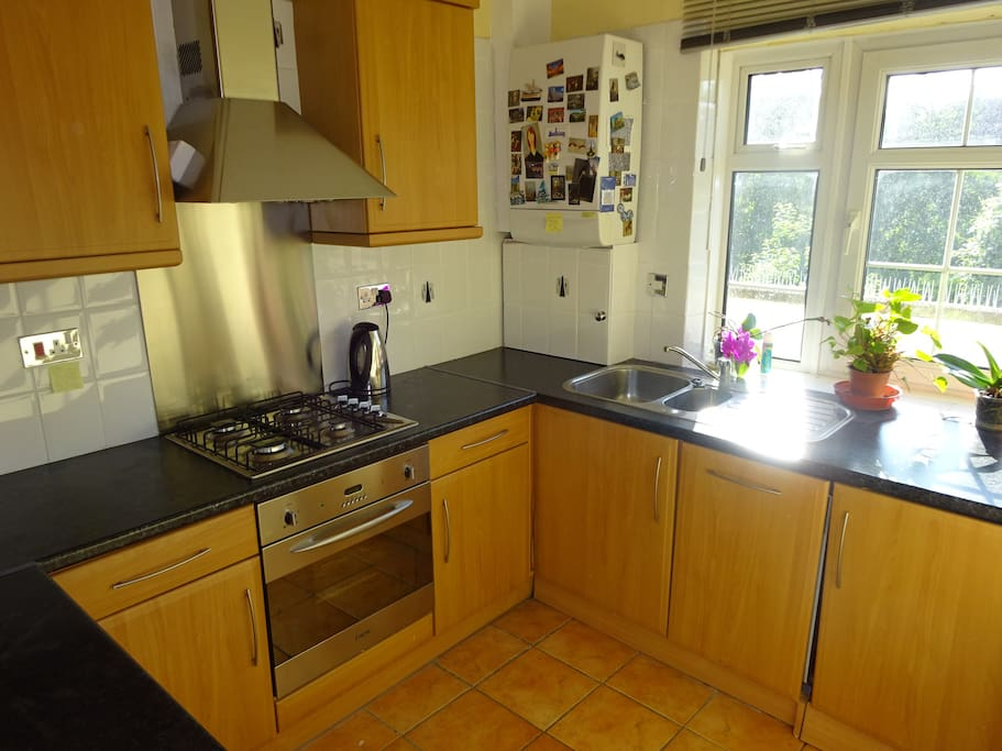 Well-appointed kitchen w iron, fridge, washer dryer, microwave, dishwasher, toaster, slow cooker, oven etc