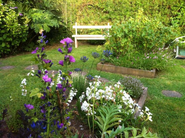 There is a secluded garden next to a stream