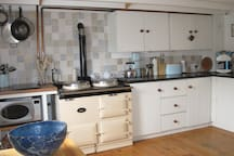 An Aga that keeps the cottage warm heats the water and offers guests a chance to cook. There is also an all in one cooker/grill microwave
