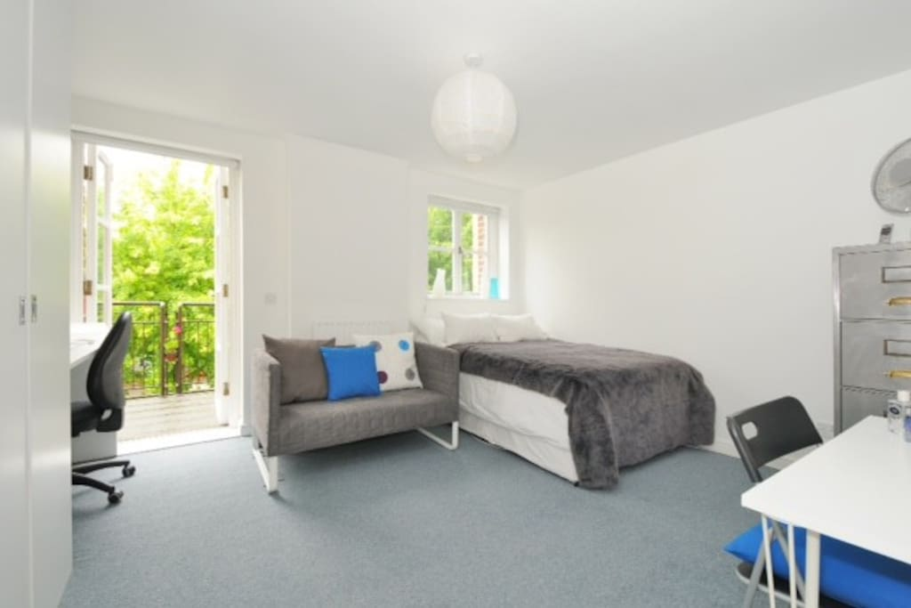 Large double room, desk if you need to work, sofa, doors to spacious balcony