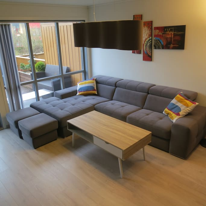 Sofa in living room with sleeping function for two persons.