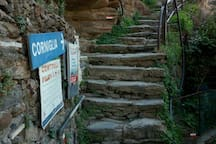 The sign of corniglia. Follow the direction of the sign until our Restaurant La Torre.