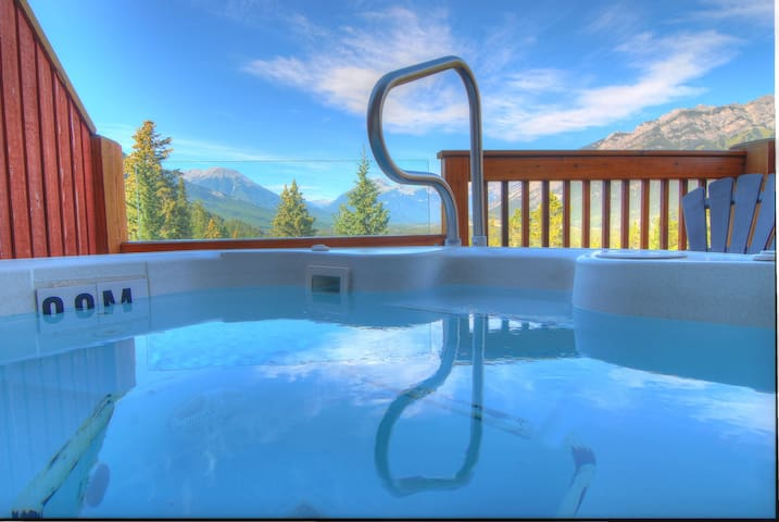 Soak in the breathtaking views from your private Jacuzzi!