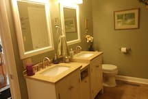 Large bath with double vanity is shared with guests in other bedroom, if any are in house.