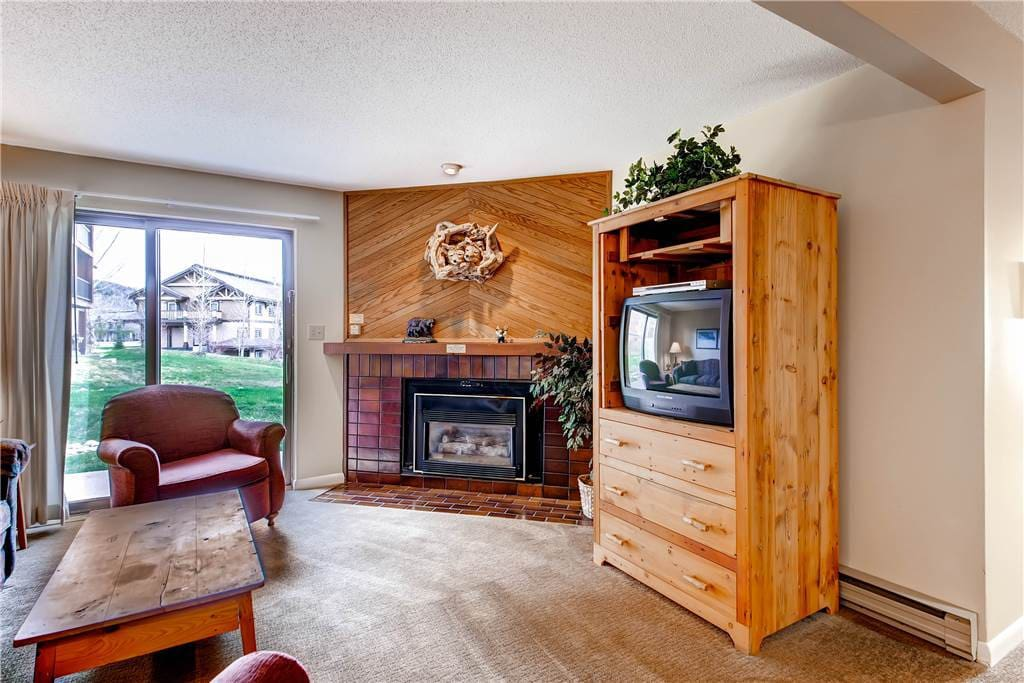 Entertainment Center,Fireplace,Hearth,Chair,Furniture
