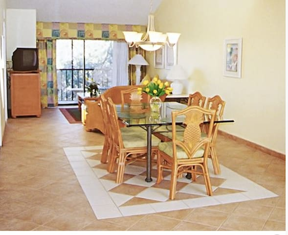 Your airy and very spacious dining table beside the living room