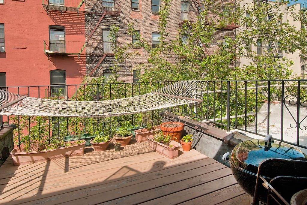 Ahhhh, the balcony - the hammock must be my favorite place in NYC! Feel free to use the BBQ too. And don't hesitate to ask about my deep fryer ;)