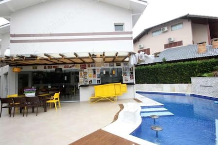 Peruíbe casa c/piscina cond.fechado Boungainville2
